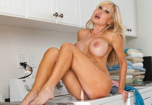 Sexy mature wife Cindi Sinderson demonstrating melons in the kitchen