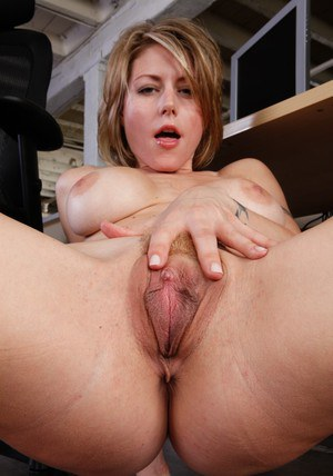 Tempting MILF Velicity Von fingering her slit and booty in the office
