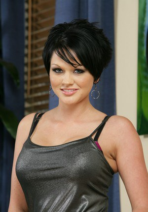 Short haired wife Cassidy Lynn playing with her melons in solo shoot