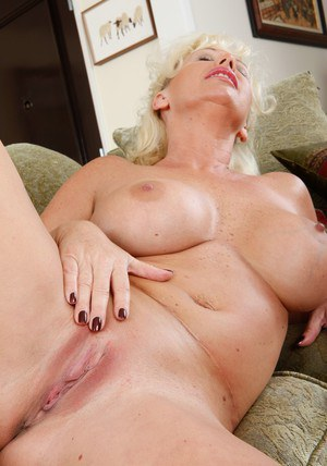 Mature BBW JoAnna Storm exposing big tits and rubbing shaved pussy
