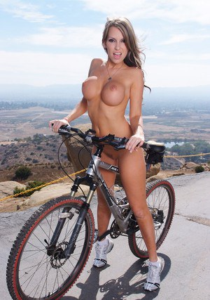 Busty girl Courtney Cummz stripping outdoor for a nude bike ride