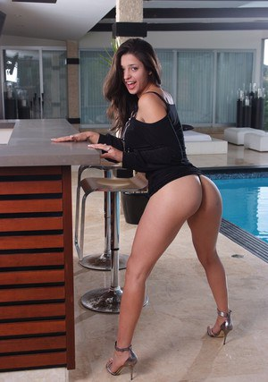 Sexy latina babe Uma Stone displaying her delicious curves at the pool