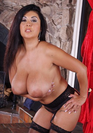 Chubby mature Jaylene Rio brings out huge tits and posing in stockings