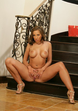 Sensuous MILF Kelly Divine strips down to expose her delicious ass