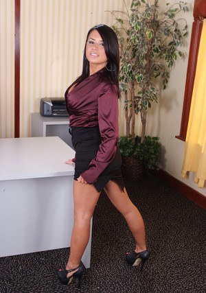 Luscious office babe Eva Angelina getting naked and posing on the desk