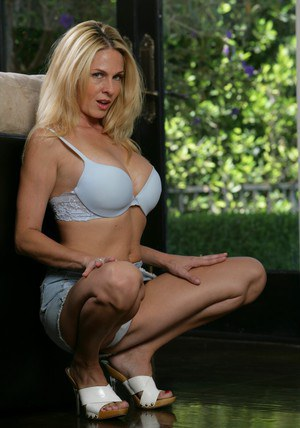 Lascivious wife in heels Angela Attison stripping from white lingerie