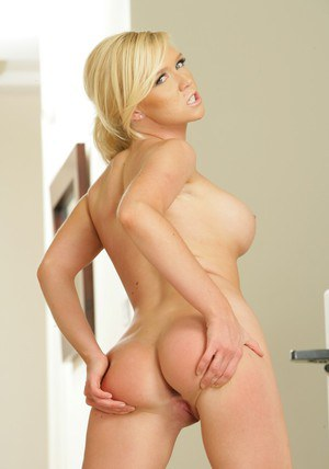 Tempting blonde Dylan Riley displaying her sporty curves and tight cunt