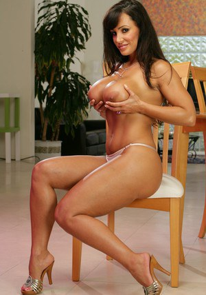 Gorgeous wife Lisa Ann exposing her booming breasts and tight booty