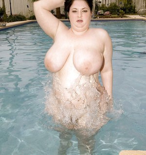 Fat brunette with lily white skin Monique L'Amour posing at the pool