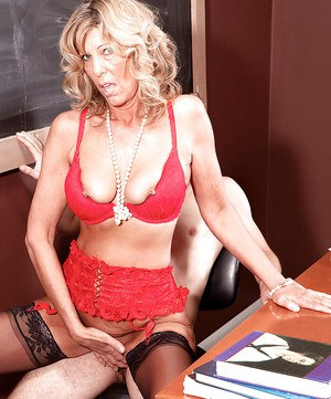 Mature teacher in red lacy lingerie Shannon West gets off with student