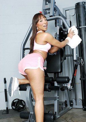 Sexy african babe Roxy Reynolds demonstrating her big butt in the gym