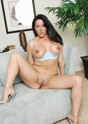 Mature brunette Sandy Beach flashing hooters and spreading shaved slit