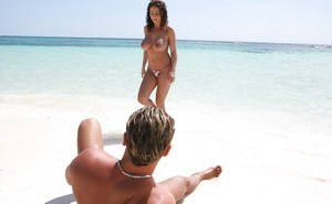Busty pornstar Roberta Misoni gets her shafted hardcore on the beach