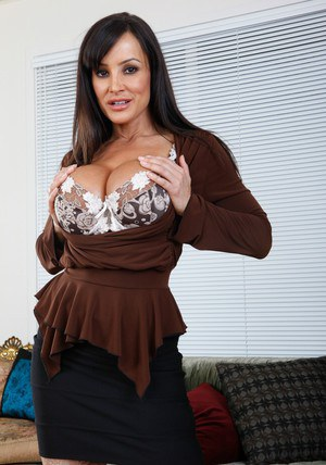 Busty MILF Lisa Ann revealing booming tits and ass from sexy lingerie