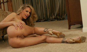 Heated mature babe Julia Ann exposing comely ass and boobs