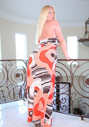 Blond BBW MILF Karen Fisher caressing her hooters and shaved slit