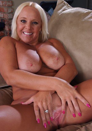 Mature blonde Alexis Golden showing off tanned tits and shaved twat