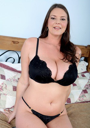 Mature brunette Carrie Moon uncovers fat boobs and spreads pussy