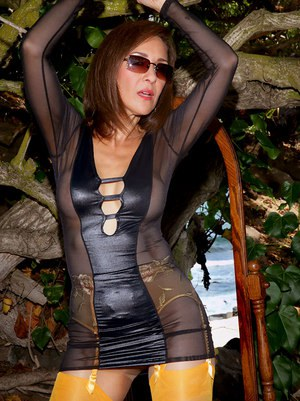Exquisite mature Roni stripping to gartered stockings on the beach
