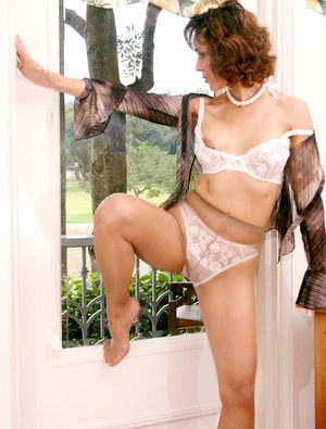 Ravishing mature babe in glasses Roni strips to white lacy lingerie