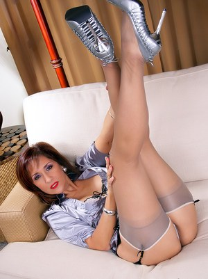 Flirtatious mature Roni in high heels and sexy corset