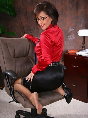 Mature office secretary showing off sexy legs in stockings and breasts