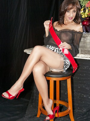 Mature hottie Roni pulling away stockings and panties to reveal pussy