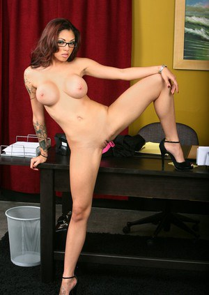 Dazzling babe in glasses strips and spreads pink on the office table