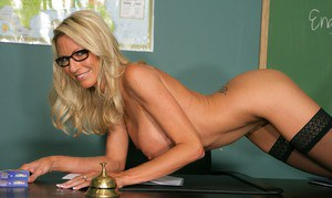 Mature teacher in glasses Emma Starr posing with tits and ass unveiled