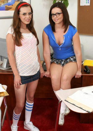 Two horny coed girls in glasses Ashley Blue and Emma Heart stripping