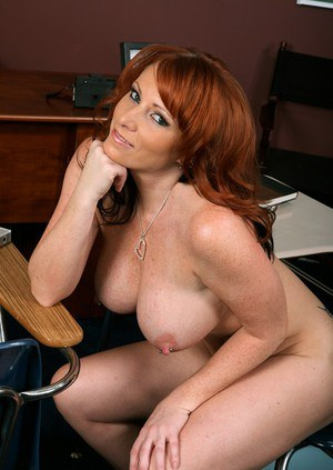 Redheaded MILF teacher Kylie Ireland strips huge tits from black bra