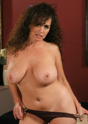Busty mature Keisha brings out massive tits and spreads pink pussy