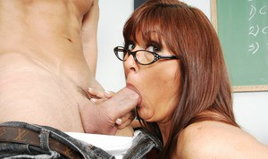 Raunchy teacher in glasses Desi Foxx gets her mature pussy stuffed