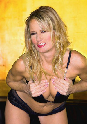 Blond MILF Bridgett Lee flaunting with her tits and big ass exposed