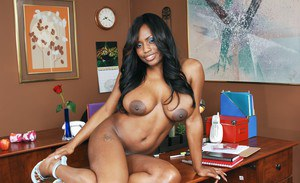 Black seductress Jada Fire revealing big tits and booty in the office