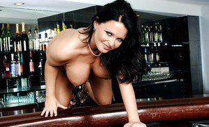 Fat busty mom Maya Divine stripping and posing on the bar counter