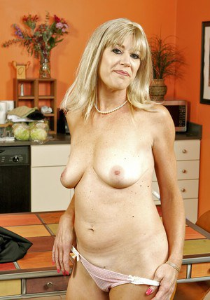 Mature teacher with big tits Liz Summers strips nude and masturbates