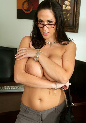 Ravishing office babe in glasses strips her massive boobs from a bra