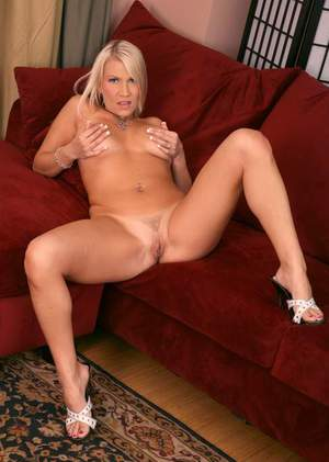 Busty MILF Xana Sta spreading hot pussy and fondling puffy tits