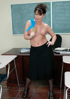 Mature sex teacher in stockings Maya Divine flaunting topless in class