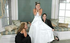 Busty blonde Nikki Benz helping Penny Flame to try on wedding dress