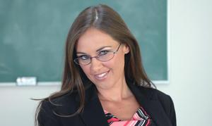 Graceful teacher in glasses Simone Riley strips and shows mature pussy