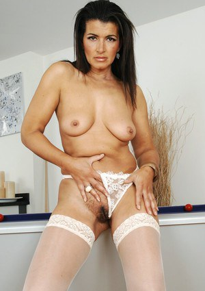 Mature brunette Georgia Smith strips to white lace top stockings