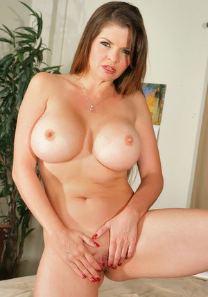 Mature babe June Summers strips and demonstrates ripe tits and booty