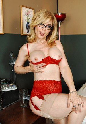 Sultry MILF in stockings and glasses Nina Hartley spreading her cunt