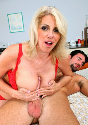 Mature blonde Penny Porsche giving titjob and fucking hardcore