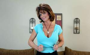 Nasty mom Deauxma revealing huge round boobs and ass from lingerie