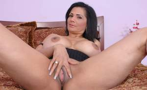 Mature latina babe Tiana Rose revealing massive hooters and spreading