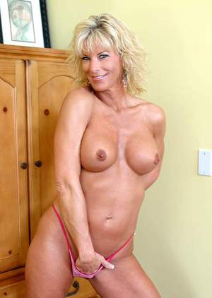 Lascivious MILF TJ Powers demonstrates comely tits and poses in heels