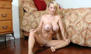 Busty mom Erika Lockett strips huge round tits and spreads mature pussy